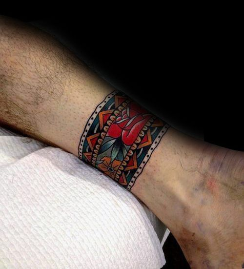 tattoo trends ankle band old school traditional flower tattoo design on man tattooviral. Black Bedroom Furniture Sets. Home Design Ideas